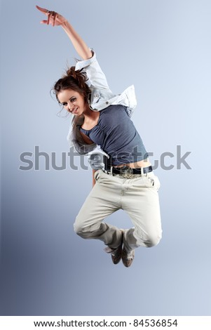 A couple of young man and woman dancing hip-hop at studio. - stock photo