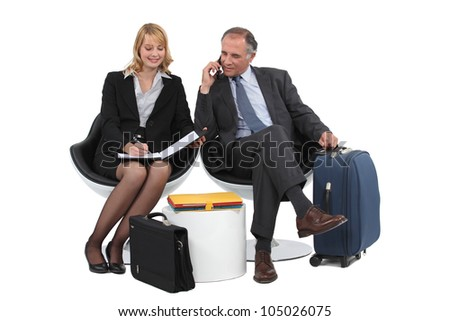 A couple on a businesstrip. - stock photo