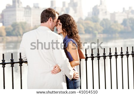 A couple on a date in a city park - stock photo