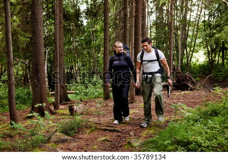 A couple on a hiking camping trip in the forest