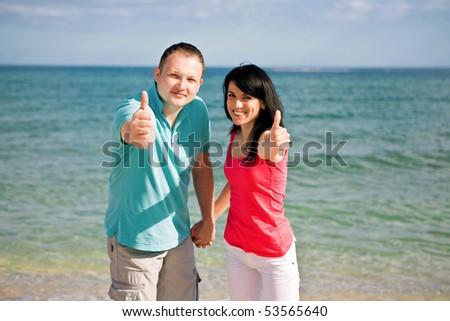 A couple on beach have fun - stock photo