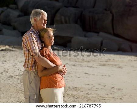A couple on the beach. - stock photo