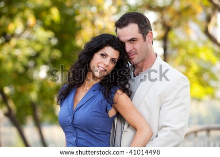 A couple portrait - in love in the park - stock photo