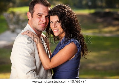 A couple posing for an engagement portrait - stock photo
