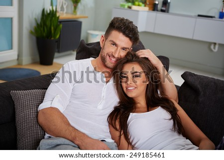 a couple relaxing on a sofa in an apartement - stock photo