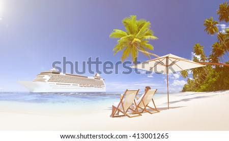 A couple relaxing on the beach. - stock photo