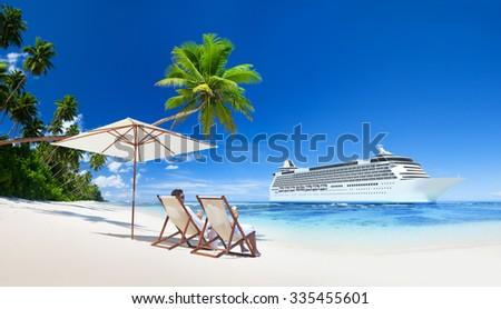 A couple relaxing on the beach Cruise Ship Concept - stock photo
