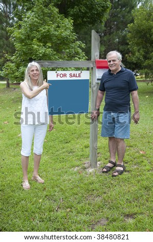 A couple reluctantly sells their home. - stock photo