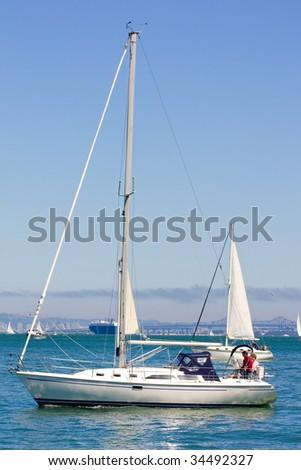 A couple sailing in a yacht at Sausalito California. - stock photo