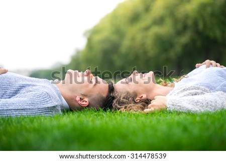 A couple walking in the Hyde Park, London - stock photo