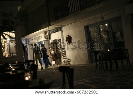 A couple walks while they are holding their hands in the main city of Naxos island, Greece, on the 17th of August 2015.