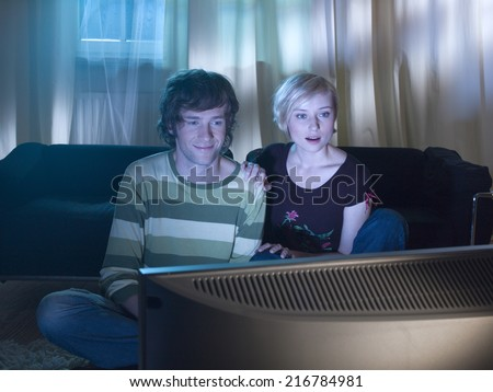 A couple watching a movie. - stock photo