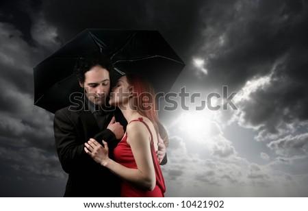 a couple with umbrella - stock photo