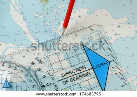A course being plotted on an old chart with a pencil and course plotter - stock photo