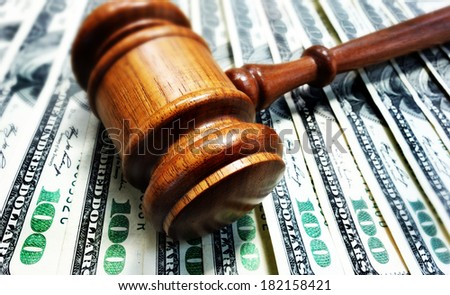 A court gavel on 100 bills - legal concept                                - stock photo