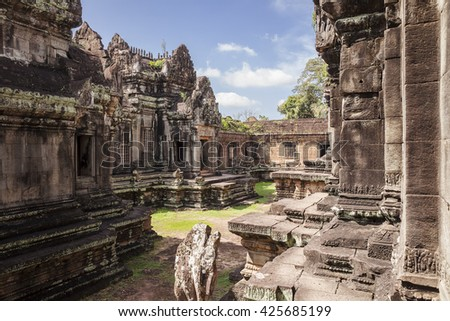 A courtyard in the Banteay Samre temple near Angkor Wat in Cambodia. The temple buildings are located on both sides of the green space.