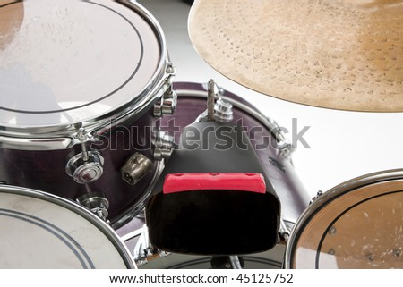 A cow bell and drum set isolated on white