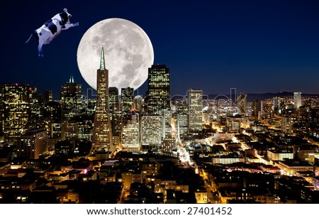 A cow jumping over the moon - stock photo