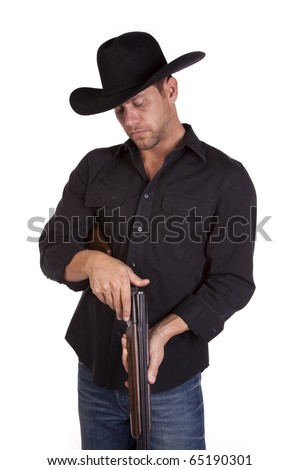 a cowboy checking his gun for bullets .