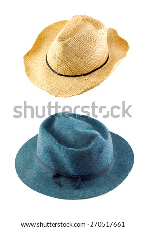 A cowboy hat and a blue hat isolated on a white vertical background