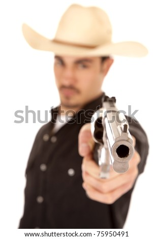 A cowboy is holding and aiming a pistol - stock photo