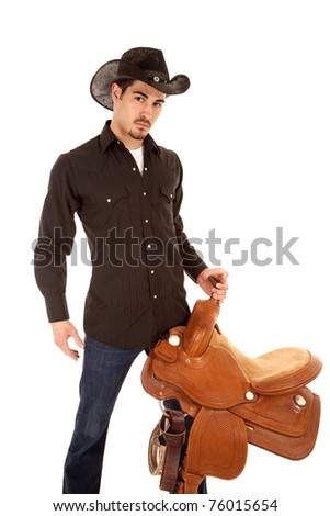 A cowboy is serious and holding a saddle on a white background. - stock photo