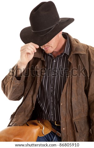 A cowboy leaning over touching his hat on a white background.