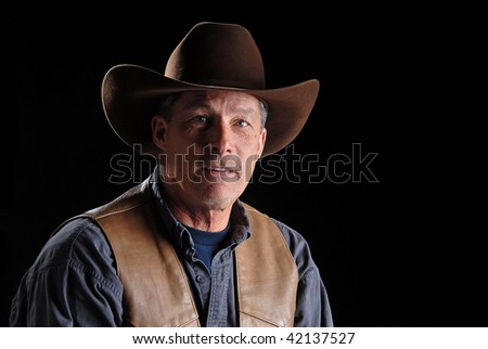 A cowboy looking at the viewer.