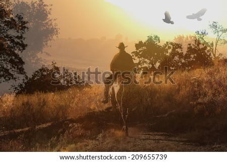 A cowboy on the trail at sunset. - stock photo