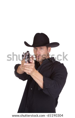 A cowboy pointing his gun and aiming it at something with a serious expression on his face. - stock photo