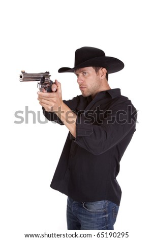 A cowboy pointing his gun and checking his aim before he shoots. - stock photo