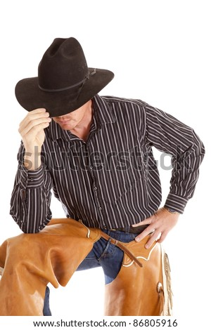 a cowboy touching his hat and bending over on a white background.