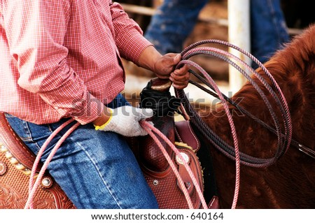 A cowboy waits to compete in the roping competition. - stock photo