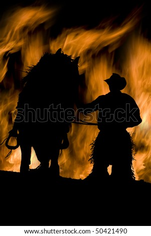 a cowboy with his horse and a fire background - stock photo