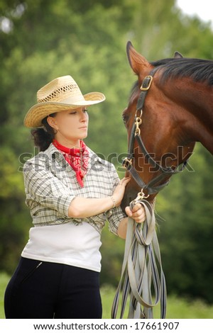 A cowgirl and a horse