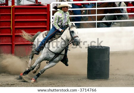 a cowgirl competing in a barrel race