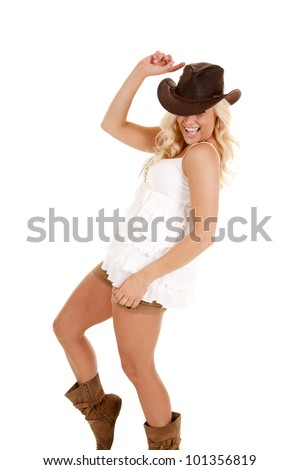 a cowgirl laughing and dancing having some fun. - stock photo