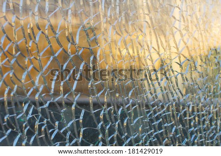 A cracked and broken glass - stock photo