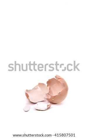 a cracked eggshell, broken eggshell on white background - stock photo