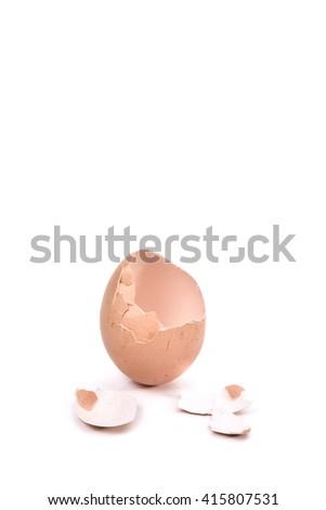 a cracked eggshell, broken eggshell on white background (selective focus) - stock photo