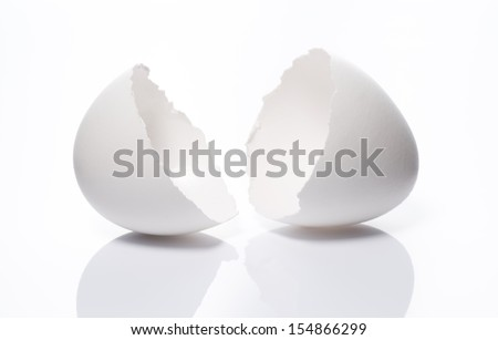 a cracked eggshell on white background - stock photo