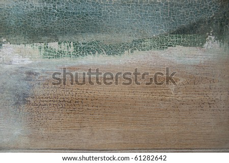 A cracked light green grunge wood background - stock photo