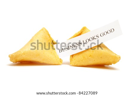 A cracked open fortune cookie stating that business looks good.