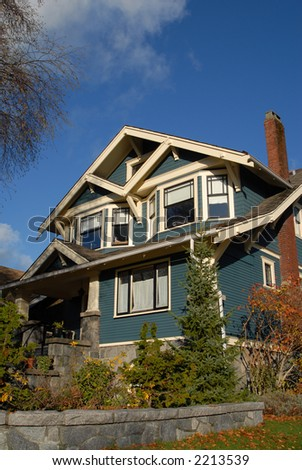 A Craftsman Style house in autumn. - stock photo