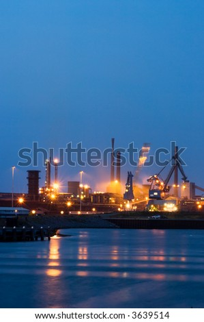 A crane moving in a steel plant at night