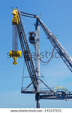 A crane used to unload cargo from the holds of ships visiting the Port of Cleveland on Lake Erie - stock photo