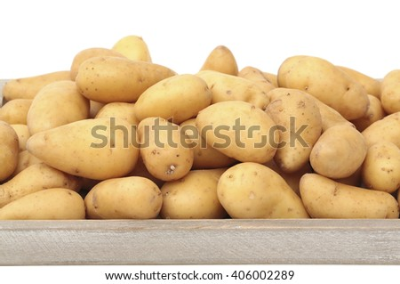 A crate filled with potatoes - stock photo