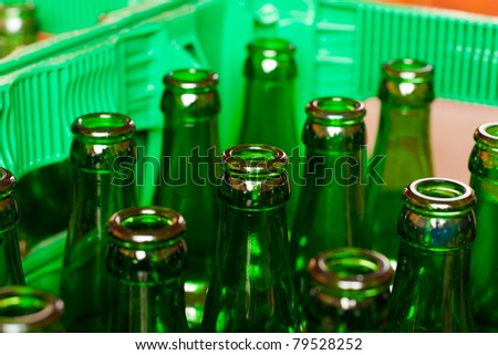 A crate of empty beer bottles. - stock photo