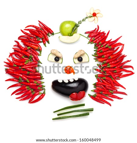 A creative food concept demonstrating a creepy halloween clown with the help of chilli pepper and other vegetables. - stock photo