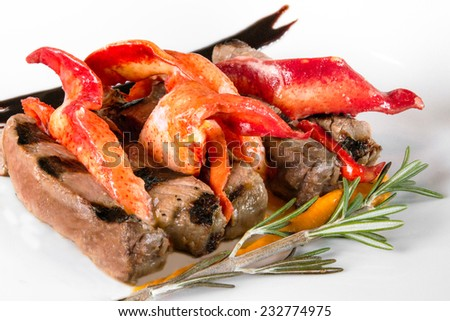 A creative plating of steak and lobster claw meat - stock photo